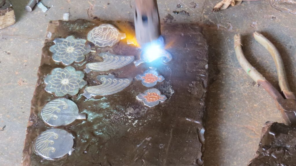 Silver inlay process for the Bidriware