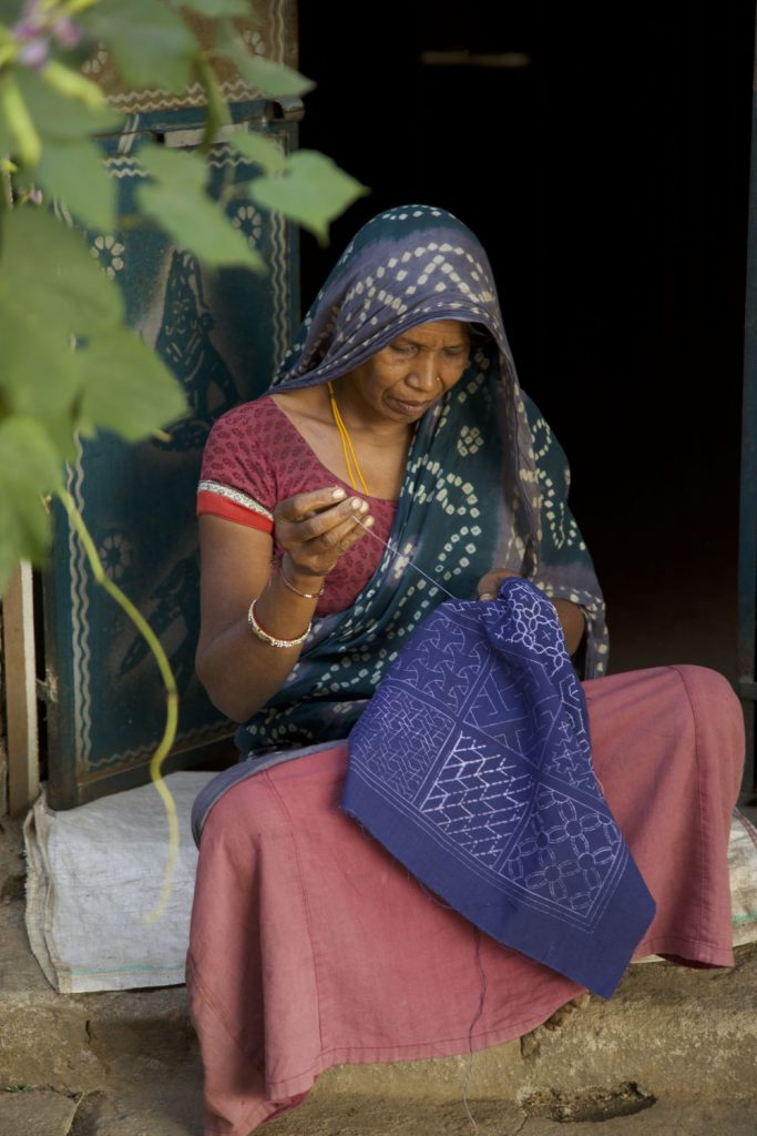 Gujrati artisan doing bead embroidery