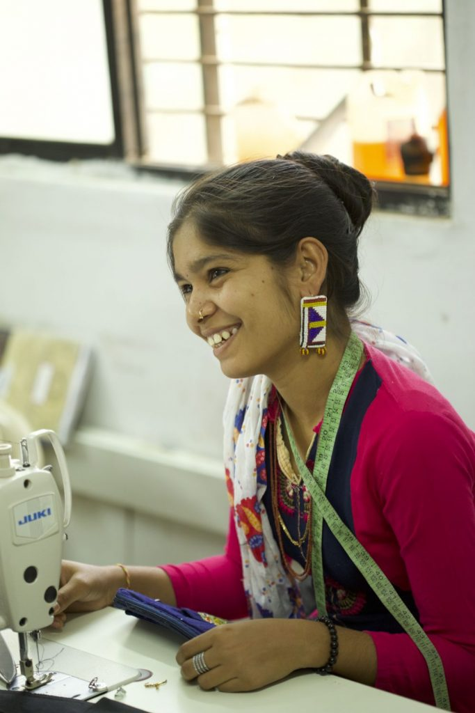 Artisan wearing a bead embroidery earring