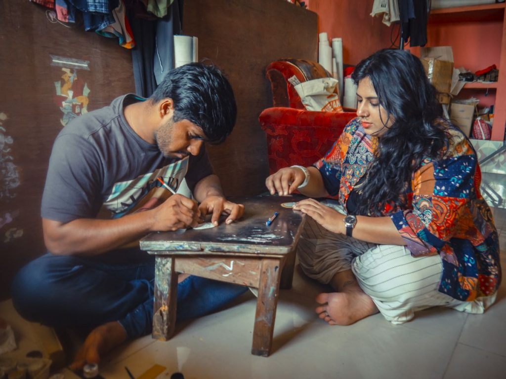 Designer Gina Joseph working on a pattachitra along with an artisan