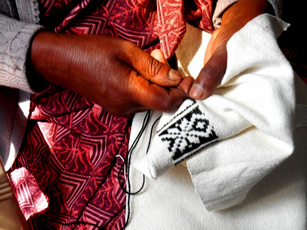 Toda embroidery by a member of the Toda community
