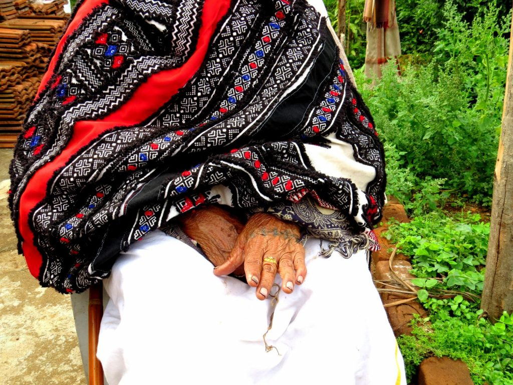 Toda embroidered shawl worn by a member of the tribe