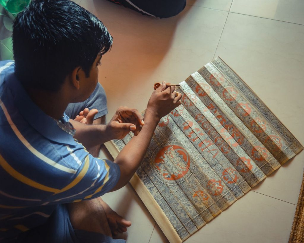 An artisan from Odisha detailing the Pattachitra painting